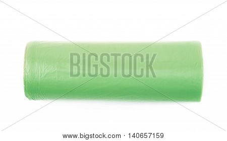 Green plastic polyethylene trash bag roll isolated over the white background
