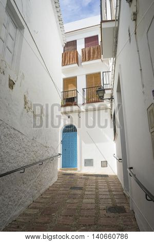 spanish, architecture and streets of white flowers in Marbella Andalucia Spain