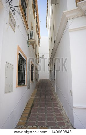 tourism, architecture and streets of white flowers in Marbella Andalucia Spain