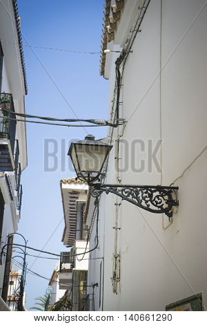 architecture and streets of white flowers in Marbella Andalucia Spain