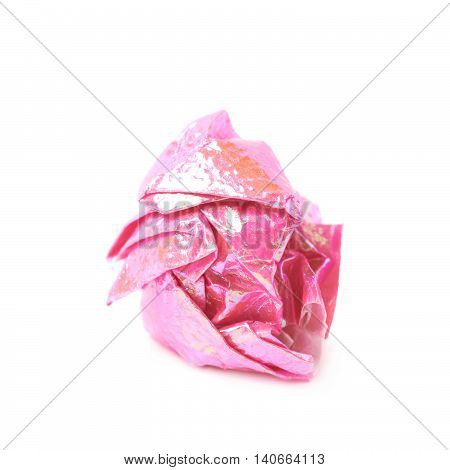 Crumbled ball of colorful origami paper sheet isolated over the white background