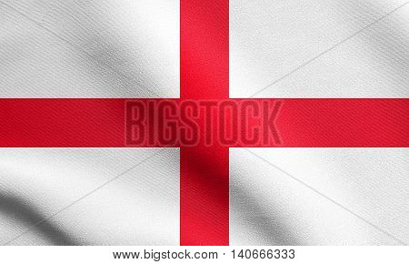 Flag of England Cross of St. George waving in the wind with detailed fabric texture. English national flag.
