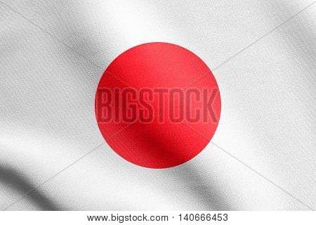 Flag of Japan waving in the wind with detailed fabric texture. Japanese national flag.