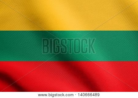 Flag of Lithuania waving in the wind with detailed fabric texture. Lithuanian national flag.