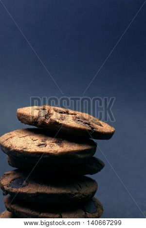 Chocolate chip cookies / A chocolate chip cookie is a drop cookie that originated in the United States and features chocolate chips as its distinguishing ingredient.