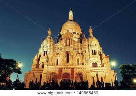 Sacre Coeur Cathedral at dusk in Paris, France.