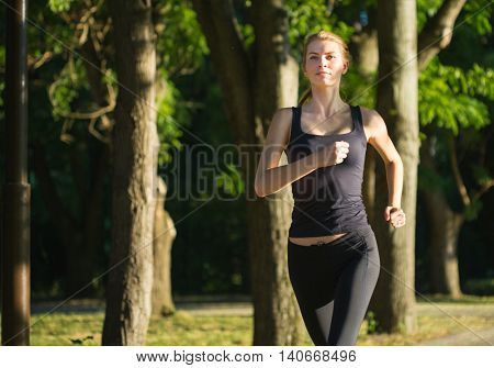 Beauty woman running in the morning park