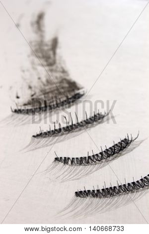 This is a photograph of fake false eyelashes on a White background