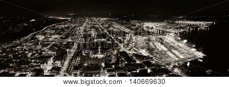 SEATTLE, WA - AUG 14: City rooftop view at night on August 14, 2015 in Seattle. Seattle is the largest city in both the State of Washington and the Pacific Northwest region of North America