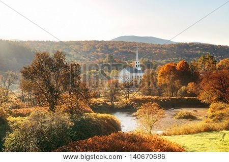 Stowe morning in Autumn with colorful foliage and community church in Vermont