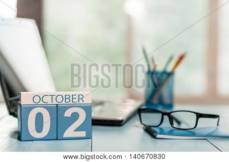 October 2nd. Day 2 of month, calendar on business office background. Autumn concept. Empty space for text.