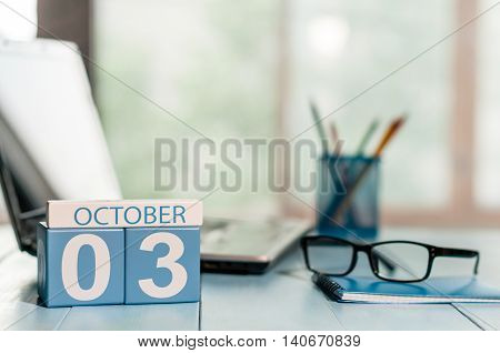 October 3rd. Day 3 of month, calendar on insurance agent workplace background. Autumn time. Empty space for text.