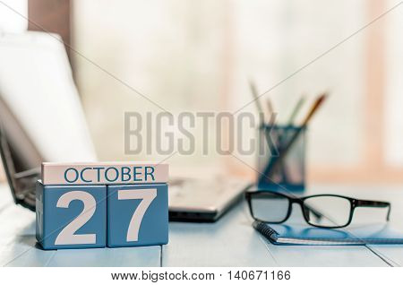 October 27th. Day 27 of month, calendar on author workplace background. Autumn concept. Empty space for text.