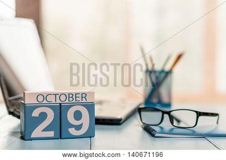 October 29th. Day 29 of month, calendar on editor workspace background. Autumn time. Empty space for text.