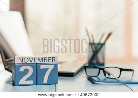 November 27th. Day 27 of month, calendar on author workplace background. Autumn concept. Empty space for text.
