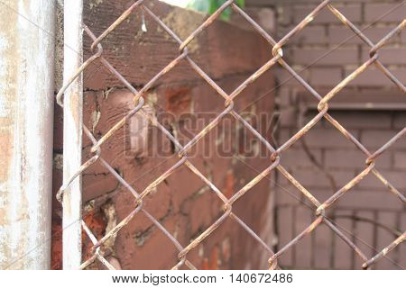Chain link fence with a brick wall.