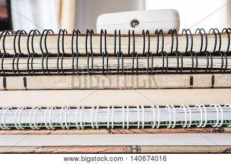 Close stacking vintage book with binder book