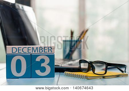 December 3rd. Day 3 of month, calendar on insurance agent workplace background. Winter time. Empty space for text.
