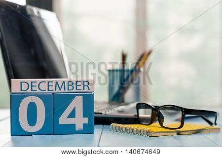 December 4th. Day 4 of month, calendar on lawyer workplace background. Winter time. Empty space for text.