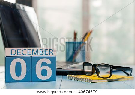 December 6th. Day 6 of month, calendar on accauntant workplace background. Winter time. Empty space for text.