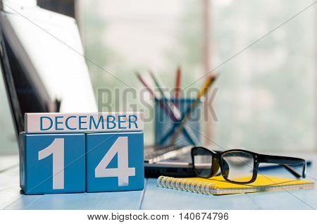 December 14th. Day 14 of month, calendar on Engineer workplace background. Winter time. Empty space for text.