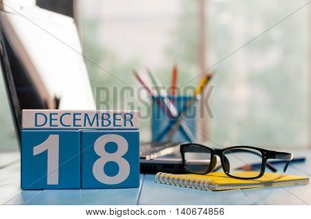 December 18th. Day 18 of month calendar on office worker workplace background. Winter concept. Empty space for text.