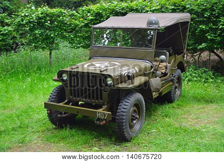 SILSOE, BEDFORDSHIRE, ENGLAND - MAY 30, 2016: World War 2 Jeep  parked in the woods.