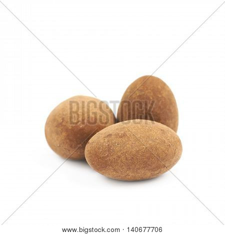 Few chocolate coated almond nuts isolated over the white background