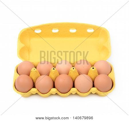 Yellow egg carton case isolated over the white background