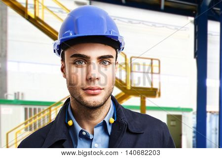 Portrait of an engineer in a production facility
