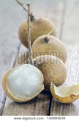 Longan or Dimocarpus longan on wooden background