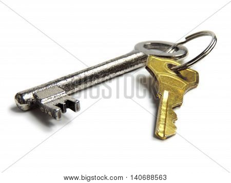 Key ring with silver and golden key, isolated on white background.
