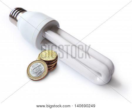 Enrgy saving light bulb and euro money. Ioslated on white background.