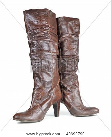 Brown leather high heels, womes shoes on white.
