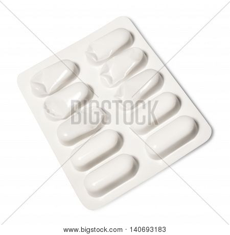 Tablets or pills in its packaging, isolated on white. Medical product.