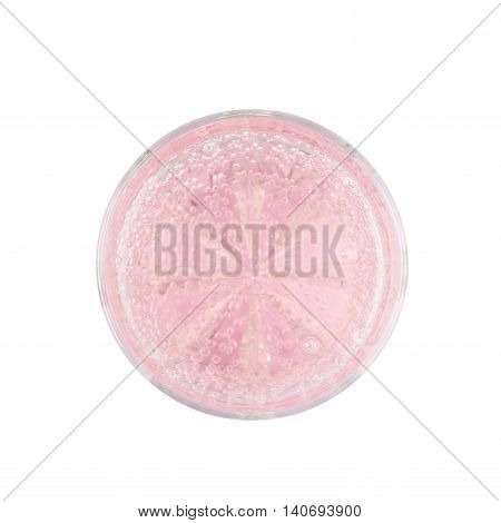 Rocks old fashioned glass filled with the carbonated pink lemonade water isolated over the white background