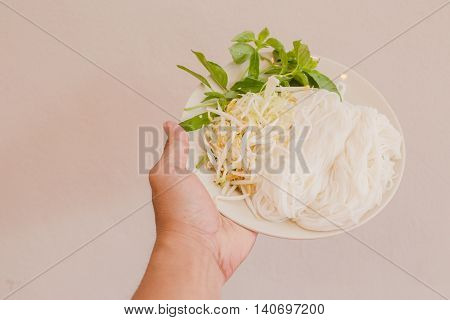 vermicelli with vegetable on dish in white background
