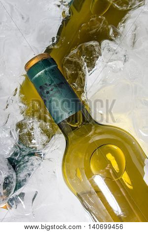 bottles of white wine in ice bucket