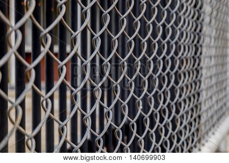 Close up Metal fence background. (Selective focus)