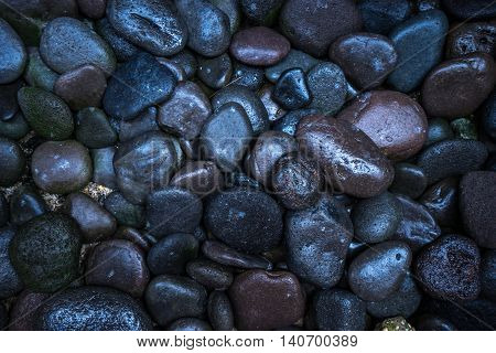 Dark texture pebble closeup. pebble texture background