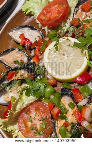 spanish traditional paella with mussels and vegetables