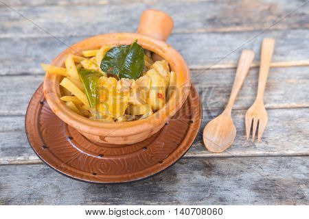 streaky pork red curry with bamboo shoot Thai favorite curry on wood background