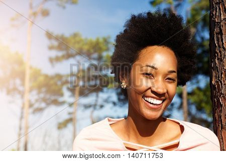 Happy Young African Woman Standing Outdoors And Smiling