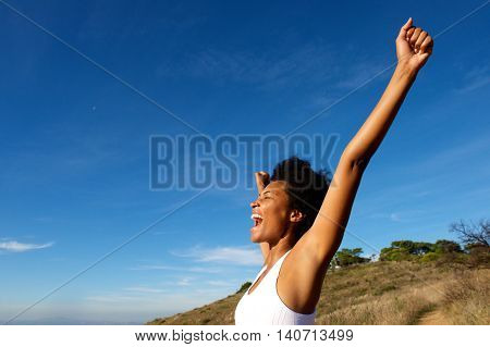 Overjoyed Fit Woman Standing Outdoors