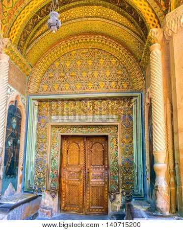 VAGHARSHAPAT ARMENIA - MAY 30 2016: The decor of the main entrance to Etchmiadzin Mother Cathedral includes gilt relief Byzantine patterns on May 30 in Vagharshapat.
