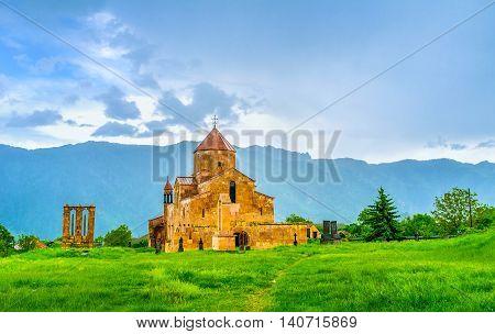 After the rain the Odzun Basilica gets brighter shade because of peculiarities of local stone Odzun Alaverdi Armenia.