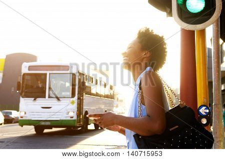 Smiling African American Woman On The City Street