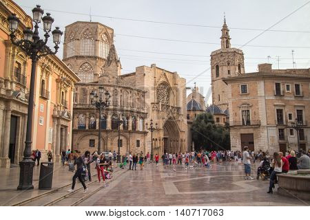 Valencia, Spain - October 19, 2014: Square of Saint Mary's, fountain Rio Turia and Valencia Cathedral in a cloudy day.