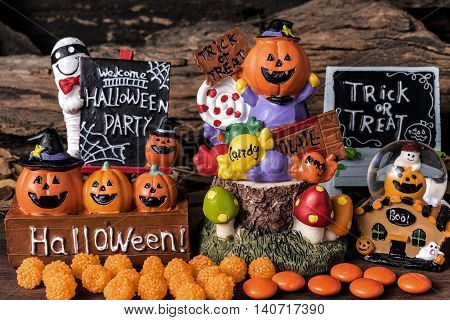 Halloween ornament party with orange candy and trick or treat board