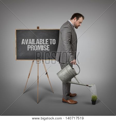 Available to promise text on  blackboard with businessman watering plant